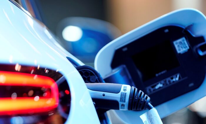 A charging port is seen on a Mercedes Benz EQC 400 4Matic electric vehicle at the Canadian International AutoShow in Toronto, Ontario, Canada, on Feb. 13, 2019. (Mark Blinch/Reuters)