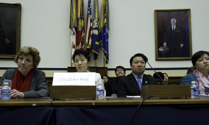 Songhwa Han (2L), former North Korean refugee detained in China, repatriated to North Korea, and detained in North Korea, and Jinhye Jo (R), former North Korean refugee detained in China, repatriated to North Korea, and detained in North Korea testify before the U.S. House Foreign Affairs Committee Congressional Executive Commission on China in Capitol Hill in Washington on March 5, 2012. (Karen Bleier/AFP via Getty Images)