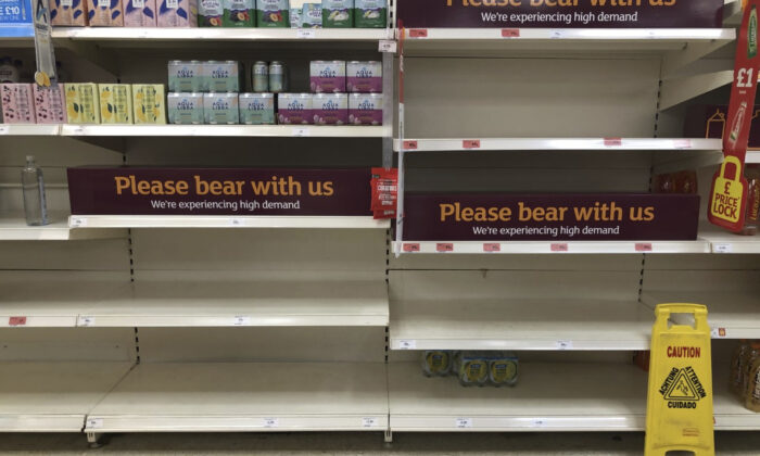 Empty shelves and signs on the soft drinks aisle of a Sainsbury's store in Rowley Regis in the West Midlands, England, on July 22, 2021. (Matthew Cooper/PA via AP)