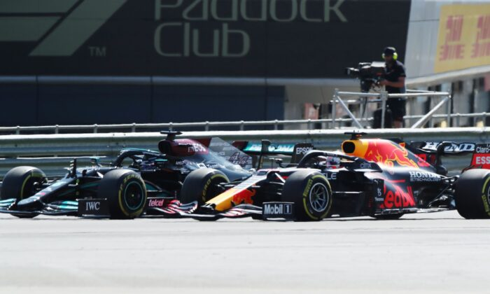 Mercedes' Lewis Hamilton and Red Bull's Max Verstappen during the race of British Formula One Grand Prix, at the Silverstone circuit, in Silverstone, England, on July 18, 2021. (Peter Cziborra/Reuters)