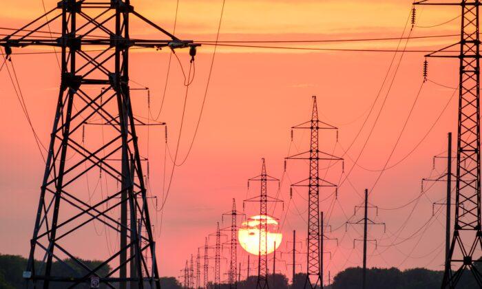Transmission lines at dusk. (Andrey Metelev / Unsplash)