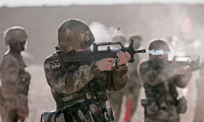 Chinese People's Liberation Army (PLA) soldiers taking part in military training at Pamir Mountains in Kashgar, northwestern China's Xinjiang region on Jan. 4, 2021.  (STR/AFP via Getty Images)