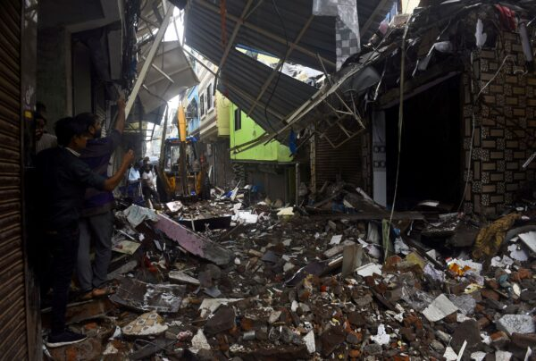 collapsed-building-india-rainfall