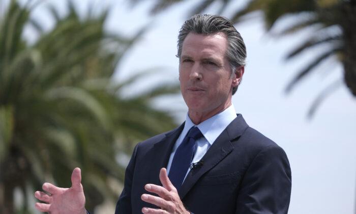 California Gov. Gavin Newsom talks during a news conference at Universal Studios in Universal City, Calif. on June 15, 2021. (AP Photo/Ringo H.W. Chiu)