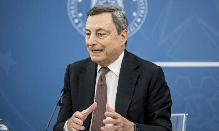 Italian Premier Mario Draghi speaks at a press conference at Chigi Palace government office in Rome, on July 22, 2021. (Roberto Monaldo/LaPresse via AP)