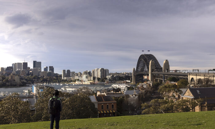 A person looks out over the Harbour Bridge from Observatory Hill in Sydney, Australia on July 20, 2021. (Brook Mitchell/Getty Images)