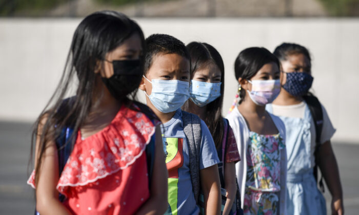 Masked students at an elementary school in Chula Vista, Calif., on July 21, 2021. (Denis Poroy/AP Photo)