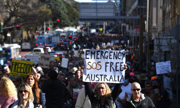 Australian protestors march along Broadway and George St towards Sydney Town Hall during the 'World Wide Rally For Freedom' anti-lockdown rally at Hyde Park in Sydney, Australia on July 24, 2021. (AAP Image/Mick Tsikas)