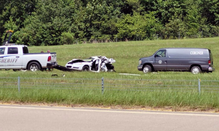 A Caddo Parish Sheriff's Office patrol car that was hit from behind by a Kia, killing a deputy who was diverting traffic around an earlier wreck on Interstate 49 in Louisiana on July 23, 2021. (Randy Bain/KTBS-TV via AP)