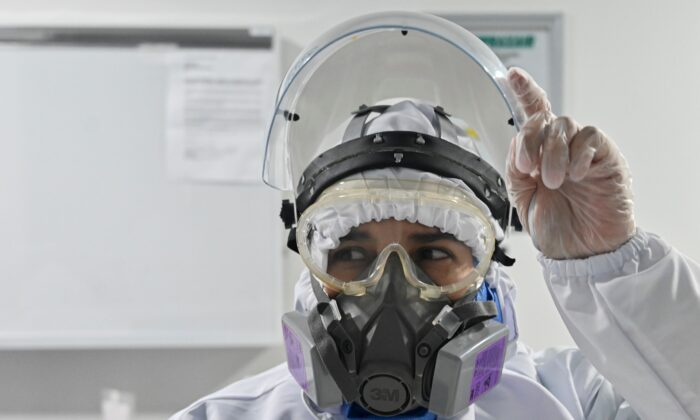 File photo of a Health worker in a biosafety suit. (Luis Robayo/AFP via Getty Images)