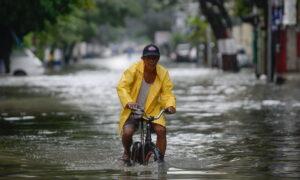 Philippines Evacuates Thousands as Monsoon Rains Flood Manila, Provinces