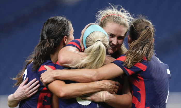 United States' Lindsey Horan, second from right, celebrates after scoring a goal during a women's soccer match against New Zealand at the 2020 Summer Olympics in Saitama, Japan, on July 24, 2021. (Martin Mejia/AP Photo)