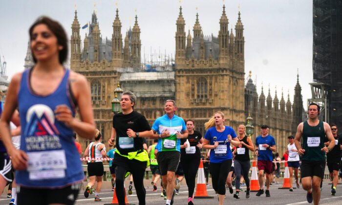 Runners cross Westminster Bridge as they take part in the Asics London 10k in central London on July 25, 2021. (Victoria Jones/PA)