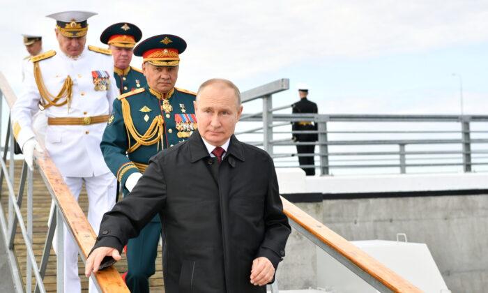 Russia's President Vladimir Putin and Defense Minister Sergei Shoigu attend the Navy Day parade in Saint Petersburg, Russia, on July 25, 2021. (Sputnik/Aleksey Nikolskyi/Kremlin via Reuters)