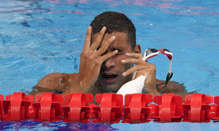 Ahmed Hafnaoui, of Tunisia, reacts after winning the final of the men's 400-meter freestyle at the 2020 Summer Olympics in Tokyo, Japan, on July 25, 2021. (Petr David JosekAP)
