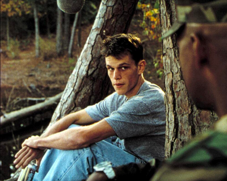 young man seated in woods and army officer standing in Courage Under Fire