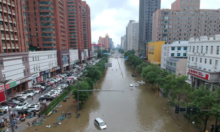 A flooded section of road in Zhengzhou, Henan Province, China, on July 21, 2021. Picture taken with a drone. (China Daily via Reuters)