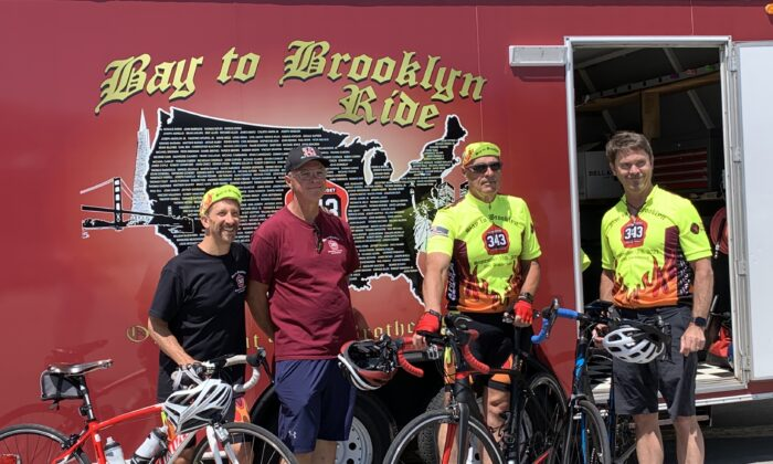 Four members of the 2021 Bay to Brooklyn team in front of the trailer on July 20, 2021. (Cynthia Cai/The Epoch Times)