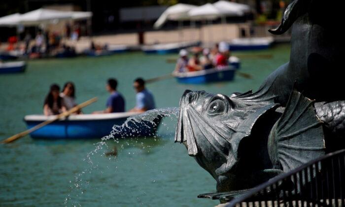 People enjoy boat rides in Retiro Park in Madrid, Spain, on June 26, 2019. (Juan Medina/Reuters)