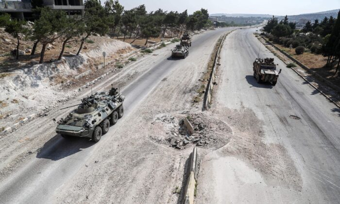 Russian and Turkish military armored vehicles and armored personnel carriers will launch an M4 high speed on July 7, 2020, connecting Aleppo and Latakia in northern Syria near Ariha in northwestern Syria, dominated by Syrian rebels. Drive together on a joint patrol along the road.  Omar Haj Kadour / AFP via Getty Images)
