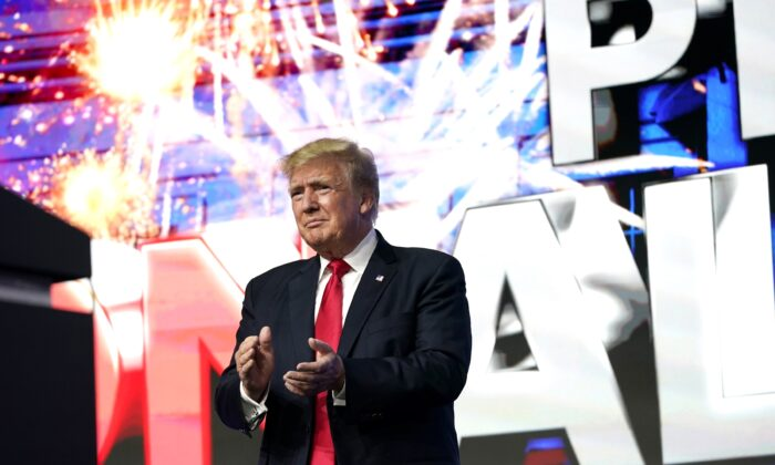 Former President Donald Trump applauds supporters prior to speaking at a Turning Point Action Summit in Phoenix, Ariz., on July 24, 2021. (Ross D. Franklin/AP Photo)