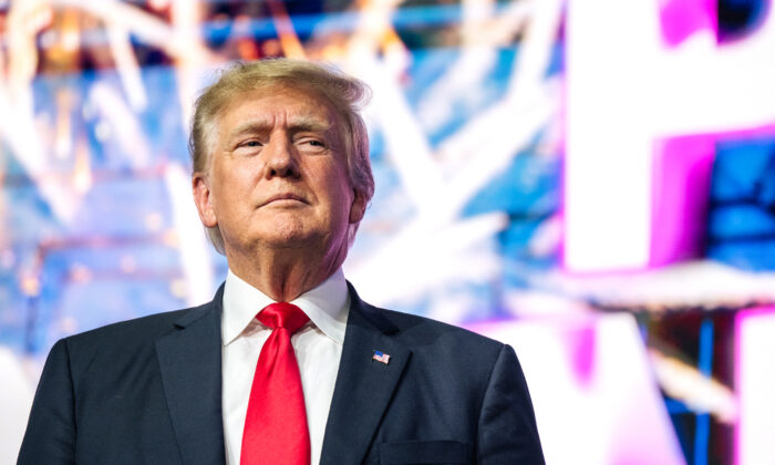 Former President Donald Trump makes an entrance at the Rally To Protect Our Elections conference in Phoenix, Ariz., on July 24, 2021. (Brandon Bell/Getty Images)