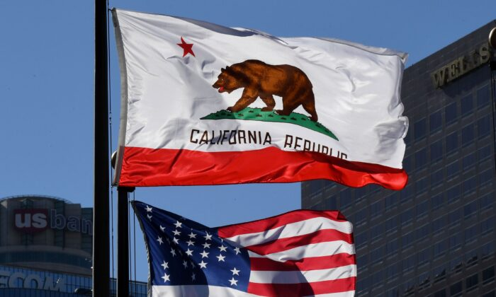 The California State flag flies beside a sign for its sister city Split outside City Hall, in Los Angeles, California on January 27, 2017. A campaign by Californians to secede from the rest of the country over Donald Trump's election is gaining steam with suporters given the green light to start collecting signatures for the measure to be put to a vote.    / AFP / Mark RALSTON        (Photo credit should read MARK RALSTON/AFP via Getty Images)
