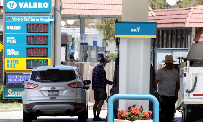 A customer prepares to pump gasoline into his car at a Valero station in Mill Valley, Calif., on July 12, 2021. (Justin Sullivan/Getty Images)