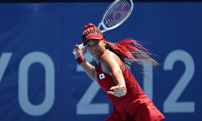 Naomi Osaka of Team Japan plays a forehand during her Women's Singles First Round match against Zheng Saisai of Team China on day two of the Tokyo 2020 Olympic Games at Ariake Tennis Park in Tokyo, Japan, on July 25, 2021. (Clive Brunskill/Getty Images)