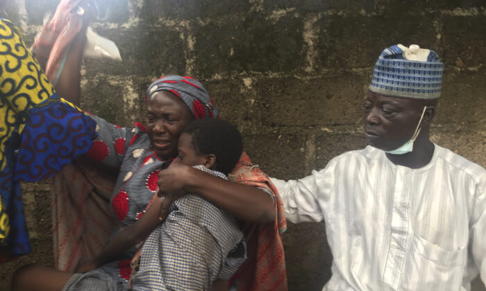 Parents are reunited with released students of the Bethel Baptist High School in Damishi, Nigeria, on July 25, 2021. (AP Photo)