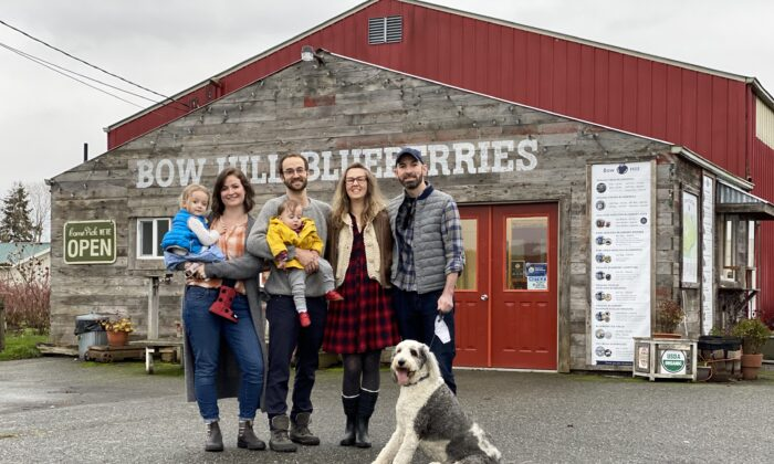(L–R) Vera, Emma, Ezra, and Soren Ranz; Audrey and Andrew Matheson; and Saoirse the sheepadoodle in front of the Bow Hill farm store in Bow, Wash. (Courtesy of Bow Hill Blueberries)