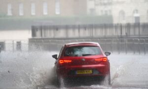 Homes, Roads, Hospitals Flooded as Storms Batter England's South