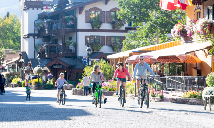 A family bikes through the village in Vail. (Jack Affleck/ Vail Local Marketing District)