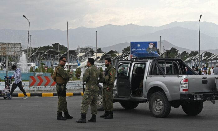 Afghan security personnel stand guard at the Hamid Karzai International Airport in Kabul on July 16, 2021. (Sajjad Hussain/AFP via Getty Images)