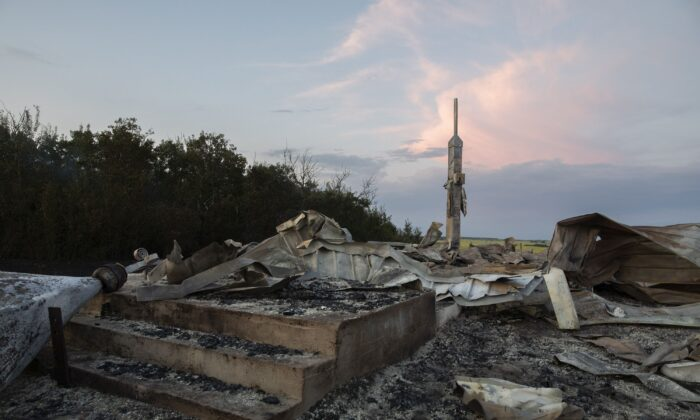Ashes and debris are all that remain after a fire at the Holy Trinity Roman Catholic Church near Orolow, Sask., on July 8, 2021. (The Canadian Press/Kayle Neis)