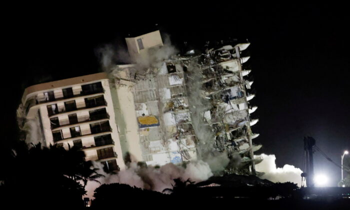 The partially collapsed Champlain Towers South residential building is demolished, in Surfside, Fla., on July 4, 2021. (Marco Bello/Reuters)