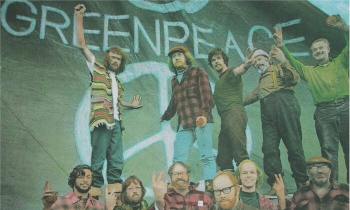 Patrick Moore (back, 2nd L) poses with other crew members of the first Greenpeace voyage from Vancouver to Alaska to protest the U.S. hydrogen bomb tests in the Aleutian Islands in September 1971. (Photo by Robert Keziere)