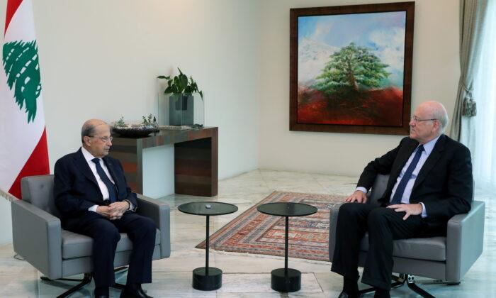 Lebanon's President Michel Aoun meets with leading businessman Najib Mikati at the presidential palace in Baabda, Lebanon, on July 26, 2021. (Dalati Nohra/Handout via Reuters)