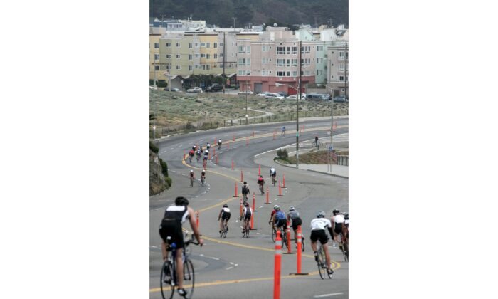 Athletes race down the north end of the Great Highway during the bike portion of the Escape from Alcatraz Triathlon in San Francisco, Calif., on June 3, 2007. (Jed Jacobsohn/Getty Images)
