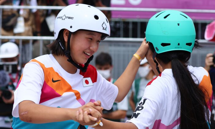 Gold medalist Momiji Nishiya of Japan and bronze medalist Funa Nakayama of Japan celebrate in Tokyo, Japan on July 26, 2021. (Reuters/Lucy Nicholson)
