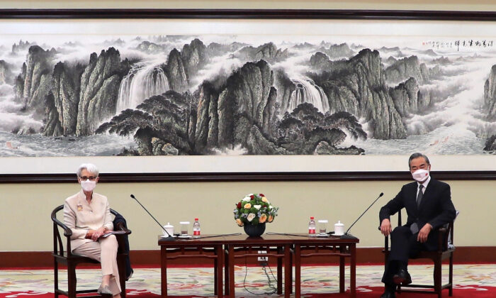 Deputy Secretary of State Wendy Sherman (L) and Chinese Foreign Minister Wang Yi sit together in Tianjin, China, on July 26, 2021. (Mark Schiefelbein/AP Photo)
