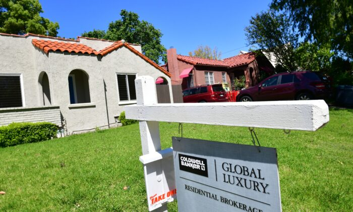 """A """"For Sale"""" sign is seen near a house in South Pasadena, Calif., on April 24, 2020. (Frederic J. Brown/AFP via Getty Images)"""