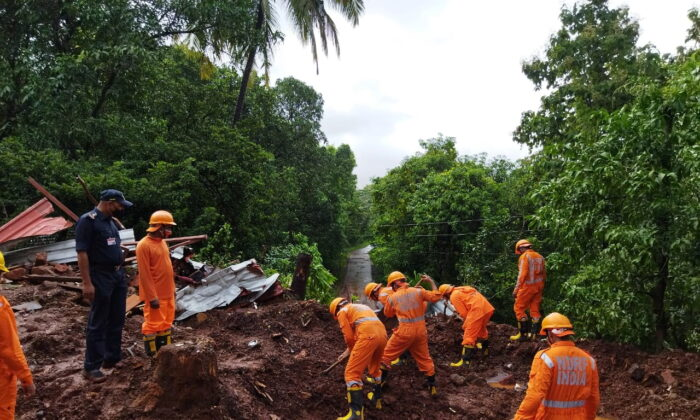 Members of National Disaster Response Force (NDRF) conduct a search and rescue operation after a landslide following heavy rains in Ratnagiri district, Maharashtra state, India, on July 25, 2021. (National Disaster Response Force/Handout via Reuters)