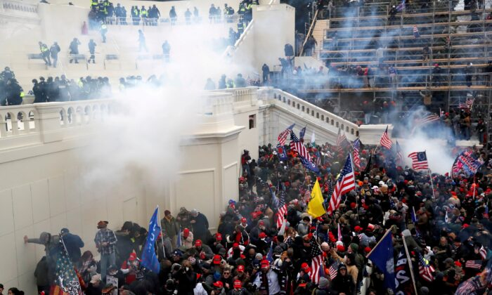Police release tear gas into a crowd during clashes at the U.S. Capitol Building on Jan. 6, 2021. (Shannon Stapleton/Reuters)