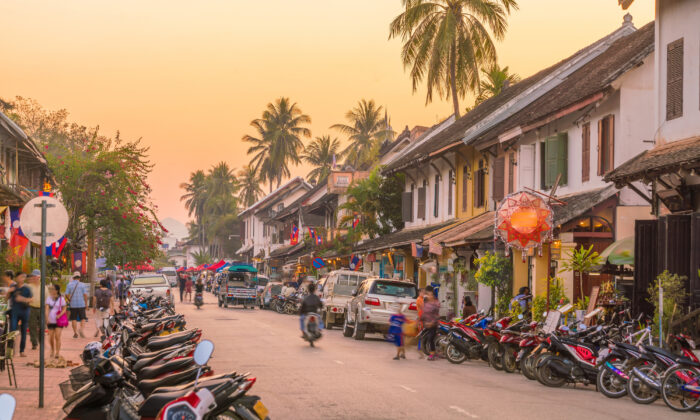 A street in old town Luang Prabang at sunset. (f11photo/Shutterstock)