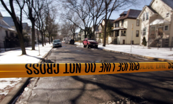 Crime-scene tape stops all but the residents at the end of the block where murder suspect Bart Ross lived on the city's northwest side March 11, 2005 in Chicago, Illinois(Photo by Scott Olson/Getty Images)