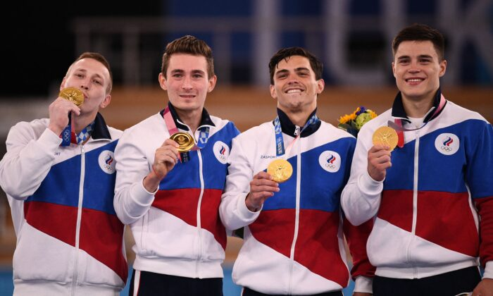 (L–R) Gold medalists Russia's David Belyavskiy, Russia's Denis Abliazin, Russia's Artur Dalaloyan and Russia's Nikita Nagornyy celebrate on the podium after winning the artistic gymnastics men's team final during the Tokyo 2020 Olympic Games at the Ariake Gymnastics Centre in Tokyo, Japan, on July 26, 2021. (Martin Bureau/AFP via Getty Images)