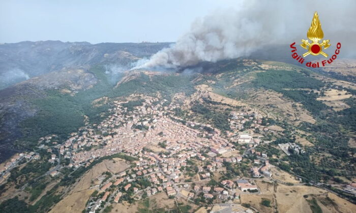 An aerial view from a helicopter shows a large wildfire that broke out near Santu Lussurgiu, Sardinia, Italy, on July 25, 2021. (Vigili del Fuoco/Handout via Reuters)