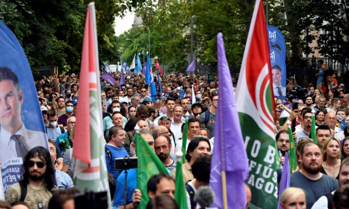 People march during a protest against the Hungarian government for allegedly using Pegasus spyware to monitor journalists, opposition leaders, and activists in Budapest, Hungary, on July 26, 2021. (Marton Monus/Reuters)