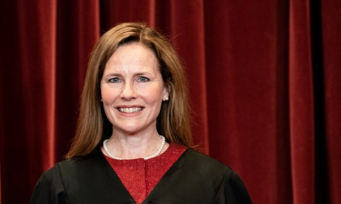 Associate Justice Amy Coney Barrett stands during a group photo of the justices at the Supreme Court in Washington on April 23, 2021. (Erin Schaff-Pool/Getty Images)
